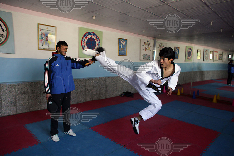 Afghanistan's first ever Olympic medallist Rohullah Nikpai, trains at his gym in Kabul. Nikpai won bronze in Taekwondo at the 2008 Olympic Games.