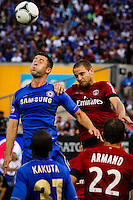 Chelsea FC player Gary Cahill (L) jumps for the ball with Paris Saint-German FC player Bodmer Mathieu during their soccer match at the Yankee Stadium in New York, July 22, 2012. Photo by Eduardo Munoz Alvarez / VIEW.