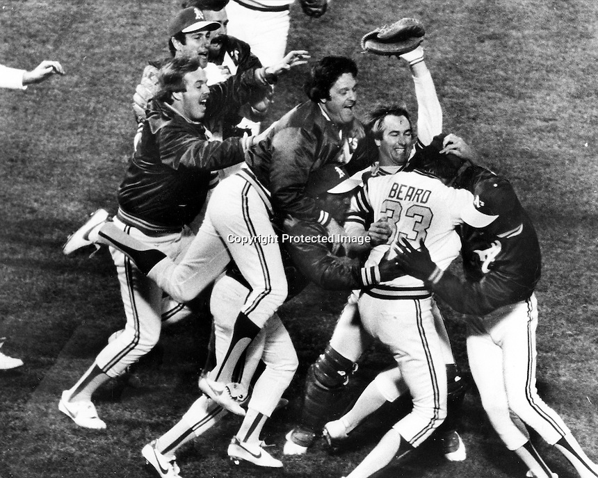 A's sweep the K.C. Royals to win the Western Division American League Playoff in 1981. Closing pitcher Dave Beard is mobbed by Jim Spencer, Mike Heath and Steve McCatty, and Rob Picciolo.<br />