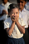 Children sing during Sunday School activities of the Methodist Church in the Cambodian village of O Kroich. The people of this village are from the Kouy indigenous group.