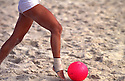 Women beach soccer, the game emphasises skill and agility, the irregularity of the soft-sand playing surface leads to a totally different style of play than is used in football, with a greater degree of improvisation. Barra da Tijuca beach, Rio de Janeiro, Brazil.