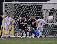 D.C. United goalkeeper Joe Willis (31) goes down to make a save. D.C. United defeated The Vancouver Whitecaps FC 4-0 at RFK Stadium, Saturday August 13 , 2011.
