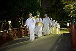 Priests head for Yuigahama beach to take part in  the hamaorisai ritual during the annual Reitaisai Grand Festival at Tsurugaoka Hachimangu Shrine in Kamakura, Japan on  14 Sept. 2012.  Sept 14 marks the first day of the 3-day Reitaisai festival, which starts early in the morning when shrine priests and officials perform a purification ritual in the ocean during a rite known as hamaorisai and limaxes with a display of yabusame horseback archery. Photographer: Robert Gilhooly