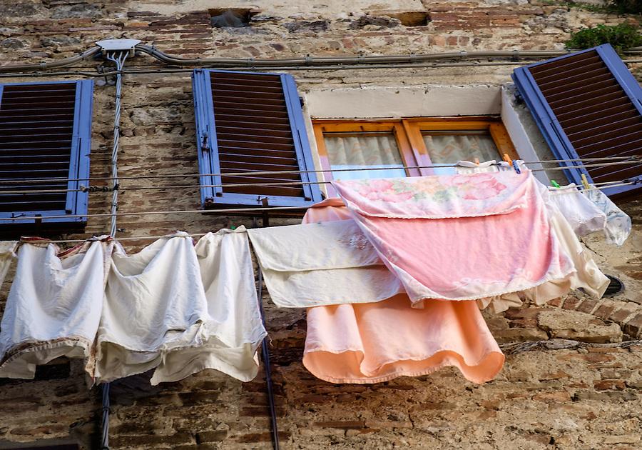 SAN GIMIGNANO, ITALY - CIRCA MAY 2015:  Typical windows and garment hangers  in San Gimignano in Tuscany