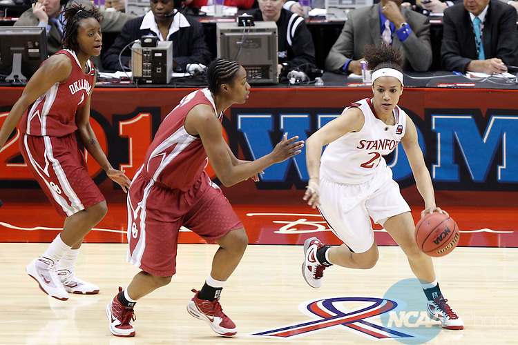 04 APR 2010:  Stanford University guard Rosalyn Gold-Onwude (right) dribbels around University of Oklahoma forward Amanda Thompson (left) during the Division I Women's Basketball Semifinals held at the Alamodome during the 2010 Women's Final Four in San Antonio, TX.  Stanford defeated Oklahoma 73-66.  Trevor Brown, Jr./NCAA Photos