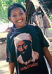 Smiling girl shows off her Osama bin Laden t-shirt.