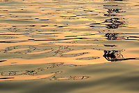 &quot;Aerial Lift Bridge Puzzle&quot;<br /> <br /> The setting sun and smooth water movement created this puzzle-like reflection of the Aerial Lift Bridge in Duluth. The conditions made for a rare sunset canoe outing on Lake Superior.