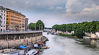 Fine Art Print Photograph. Landscape scenic on the Tiber river. This scene depicts a lovely curved road that is lined with colourful buildings along the Tiber river.<br />
