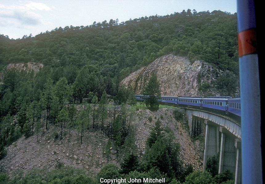 Original Ferrocarriles Nacional de Mexico train crossing a bridge, Copper Canyon, Chihuahua, Mexico. This is an archival image taken in 1990.