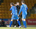 St Johnstone v Inverness Caley Thistle....02.01.11  .Derek McInnes hugs Chris Millar and Dave Mackay at full time.Picture by Graeme Hart..Copyright Perthshire Picture Agency.Tel: 01738 623350  Mobile: 07990 594431