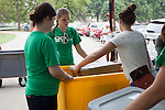Beth Foreman, left, and Phoenix Crane, help a student load up a cart to help with moving into a residence hall on Friday, August 19, 2016. © Ohio University / Photo by Kaitlin Owens