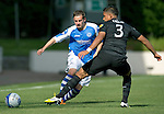 St Johnstone v Celtic....15.09.12      SPL  .Determination on the face of Peter Pawlett as he goes by Emilio Izaguirre.Picture by Graeme Hart..Copyright Perthshire Picture Agency.Tel: 01738 623350  Mobile: 07990 594431