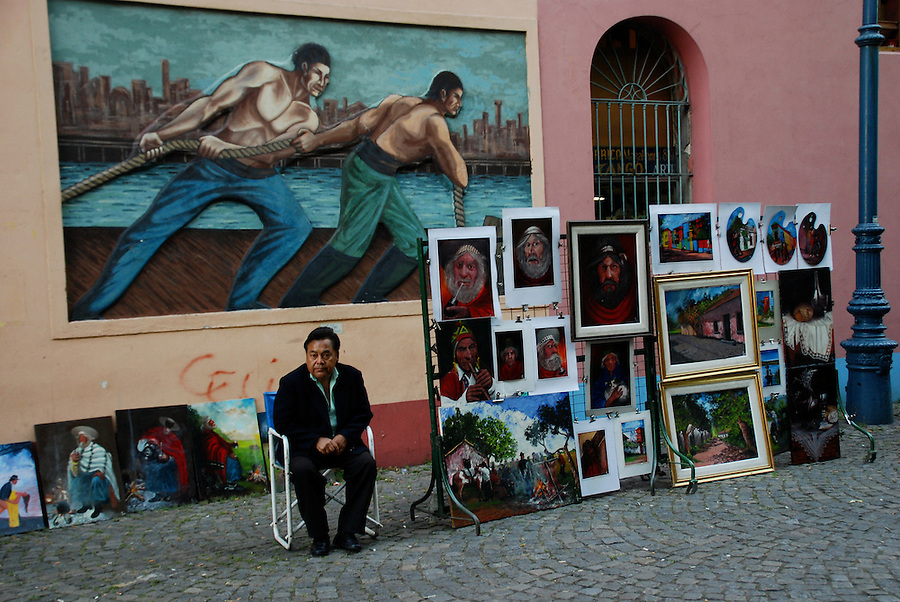 Artist selling his work con Caminito Street, in Buenos Aires