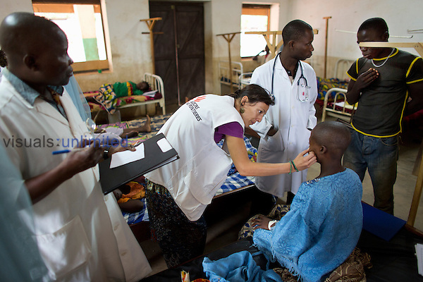MSF doctor and staff with patient in Batangafo Hospital, Central African Republic
