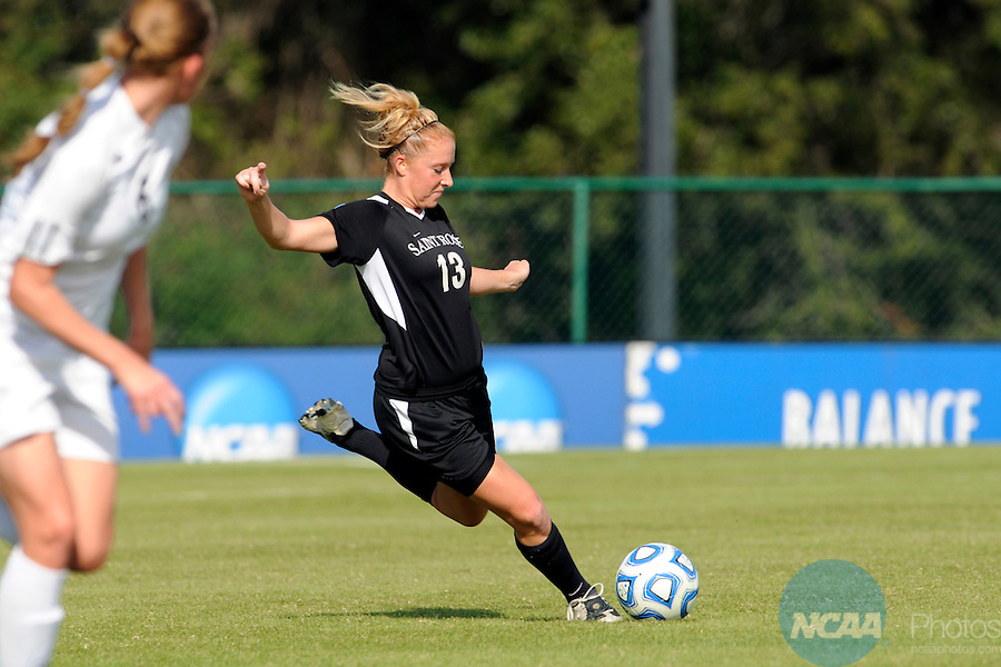 03 DEC 2011: Christina Cuffari (13) of Saint Rose passes the ball down field during the Division II Women's Soccer Championship held at the Ashton Brosnaham Soccer Complex in Pensacola, FL.  Saint Rose defeated Grand Valley State 2-1 to win the national title.  Stephen Nowland/NCAA Photos