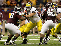 Michael Schofield of Michigan in action during Sugar Bowl game against Virginia Tech at Mercedes-Benz SuperDome in New Orleans, Louisiana on January 3rd, 2012.  Michigan defeated Virginia Tech, 23-20 in first overtime.