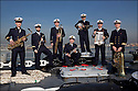 Major Pierre Cano / Trompette<br /> Ma&icirc;tre principal Charles Renaud / Wash Board<br /> Premier ma&icirc;tre Guy Duverget : Trombone<br /> Premier ma&icirc;tre Christophe Criado / Banjo<br /> Ma&icirc;tre Ferjeux Beauny / Saxophone<br /> Second ma&icirc;tre Sylvain Therond / Clarinette<br /> Ma&icirc;tre Vincent Ollier / Tuba<br /> LES MUSICIENS DE LA FLOTTE