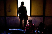 Local villagers take shelter at a community centre while security forces are seen provide security at Jowai village. On 8th May 200, suspected Zeme Naga groups attacked a Dimasa village and burnt down 10 out of 13 houses. In this act of violence, they spared the school and the community centre, where most of the families are taking shelter. Ethnic clashes are regularly taking place between Zeme Nagas and the Dimasa tribe in North Cachar Hills in Assam, India.