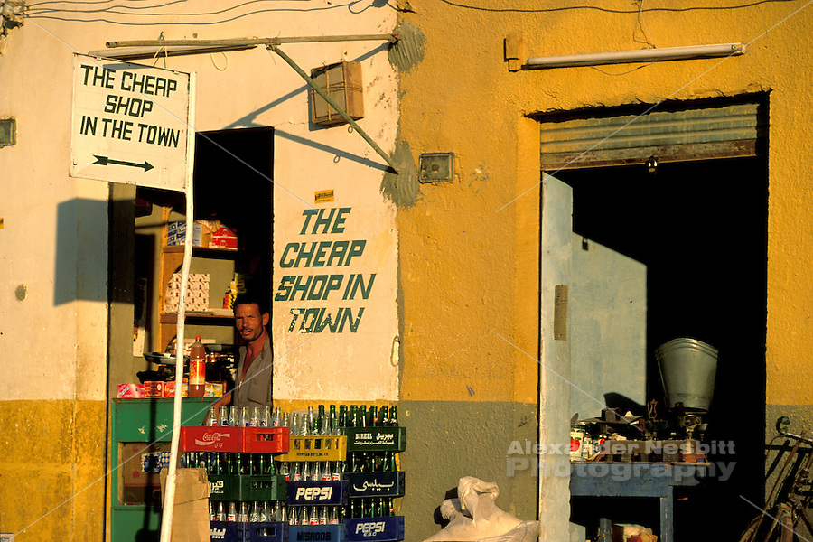 """Egypt, 2000 -  An Egyptian store cleverly advertises its advantages. """"The Cheap Shop in Town."""""""