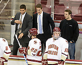 Tommy Cross (BC - 4) and Kevin Hayes (BC - 12) joke around on the bench during warmups.  Jerry York announced in his press conference that while Cross's recent knee injury had healed, his other knee was injured when he resumed skating and he will not return to the lineup until January.  York also mentioned that Hayes was doubtful for the BU series due to his knee injury. - The Boston College Eagles defeated the visiting University of Maine Black Bears 4-0 on Friday, November 19, 2010, at Conte Forum in Chestnut Hill, Massachusetts.