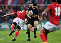 Nehe Milner-Skudder of New Zealand takes on the Tonga defence. Rugby World Cup Pool C match between New Zealand and Tonga on October 9, 2015 at St James' Park in Newcastle, England. Photo by: Patrick Khachfe / Onside Images