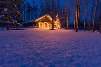 Historic log cabin in snowy Wiseman, Alaska