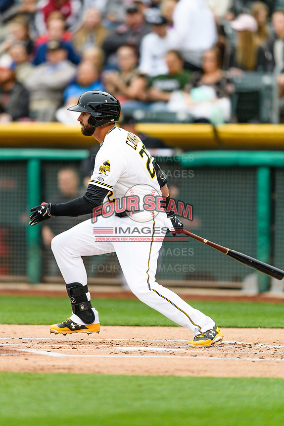 Kaleb Cowart (22) of the Salt Lake Bees follows through on his swing against the Sacramento River Cats during the Pacific Coast League game at Smith's Ballpark on August 11, 2017 in Salt Lake City, Utah. (Stephen Smith/Four Seam Images)
