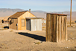 Wooden outhouse behind shack, Nevada