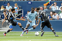 Kansas City forward C. J Sapong (17) takes on San Jose's Steven Beltashour and Khari Stephenson... Sporting Kansas City defetaed San Jose Earthquakes 2-1 at LIVESTRONG Sporting Park, Kansas City, Kansas.