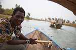 Abdoulaye Kassambara, a member of the Association of Tourist Guides and Canoeists of Segou, Mali, leads a tour to the pottery village of Kalabougou.