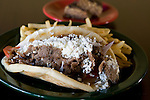 Beef and Lamb gyros with a side order of french fries  with a dish of chocolate covered bakalava at the Athina Grill at 528 Queen Anne North in Seattle on Monday, Sept. 29, 2008. . Jim Bryant Photo. ©2010. All Rights Reserved.