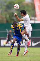 Jeffri Flores (5) of Honduras goes up for a header against Diquan Adamson (10) of Barbados  during the group stage of the CONCACAF Men's Under 17 Championship at Catherine Hall Stadium in Montego Bay, Jamaica. Honduras defeated Barbados, 2-1.