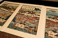 """A woodblock print showing sake brewing in Fushimi during the Edo Period. Fushimi, Kyoto, Japan, October 10, 2015. Tsukinokatsura Sake Brewery was founded in 1675 and has been run by 14 generations of the Masuda family. Based in the famous sake brewing region of Fushimi, Kyoto, it has a claim to be the first sake brewery ever to produce """"nigori"""" cloudy sake. It also brews and sells the oldest """"koshu"""" matured sake in Japan."""