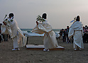 April 11, 2011, Kamakura, Japan - Three shinto priests perform a purification ritual near the water at Yugihama Beach during a special commemorative event to offer prayers for the relief of the March 11 earthquake and tsunami victims. Today is exactly one month since the devastating disaster that left Tohoku with almost nothing to spare. (Photo by Christopher Jue/AFLO) [2331].