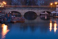 Oxford's Folly Bridge at dusk, with lights reflecting on the Thames