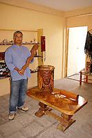 Marco Antonio Sanchez showing off handmade replicas of pre-Hispanic musical instruments in his store, Camino del Piedra, in Mineral de Pozos, Guanajuato, Mexico.