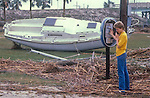 A young man checks the pay phone after Hurricane Kate in Apalachicola, Florida November 21, 1985.  Kate, a late November Hurricane,  was latest forming Atlantic hurricane on record at the time and was the second for the area following Hurricane Elena two months earlier.