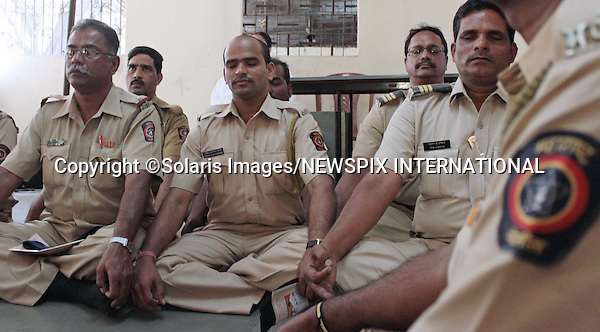 """MUMBAI POLICE TAKE STRESS MANAGEMENT CLASSES.In an effort to assist the traffic police to contend with their ever increasing traffic problems, Mumbai Police have adopted a stress management programme..A pilot project has seen 100 Mumbai police officers and constables attend the """"Traffic Control- Practicing Inner Silence"""" a unique spiritual initiative and stress management program organized by Prajapati Brahma Kumaris. .Brahma Kumaris teaches a form of meditation adherents call Raja Yoga, where """"the student or students sit in a semi-darkened room facing the teacher (usually a woman wearing white clothes) . Student and teacher gaze intently at each other, either in the eyes or at the forehead. While doing this the student is supposed to imagine him or herself as a soul and not as a body..Mandatory Photo Credit: ©Pravin Utturkar-Solaris Images/NEWSPIX INTERNATIONAL..**ALL FEES PAYABLE TO: """"NEWSPIX INTERNATIONAL""""**..PHOTO CREDIT MANDATORY!!: NEWSPIX INTERNATIONAL(Failure to credit will incur a surcharge of 100% of reproduction fees)..IMMEDIATE CONFIRMATION OF USAGE REQUIRED:.Newspix International, 31 Chinnery Hill, Bishop's Stortford, ENGLAND CM23 3PS.Tel:+441279 324672  ; Fax: +441279656877.Mobile:  0777568 1153.e-mail: info@newspixinternational.co.uk"""