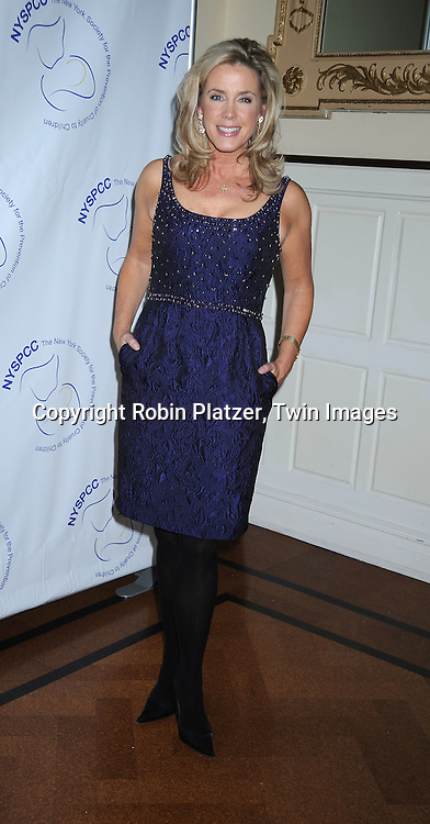 Deborah Norville in Carmen Marc Valvo purple dress