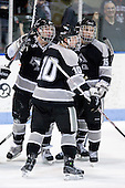 ?, Alex Velischek (Providence - 10), Kyle MacKinnon (Providence - 15) - The Northeastern University Huskies defeated the Providence College Friars 3-1 (EN) on Tuesday, January 19, 2010, at Matthews Arena in Boston, Massachusetts.