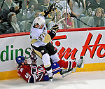3 February 2009: Pittsburgh Penguins' center Sidney Crosby stumbles over Montreal Canadiens left wing forward Andrei Kostitsyn at the Bell Centre in Montreal, Quebec, Canada. The Canadiens defeated the Penguins 4-2. ***** Editorial Sales Only ***** Mandatory Photo Credit: Ed Wolfstein Photo.