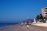 Playa Las Gaviotas beach and paragliders in the Zona Dorada or Golden Zone,  Mazatlan, Sinaloa, Mexico..