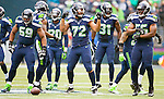 Seattle Seahawks defensive line waits for the St. Louis Rams offensive line to line up in their game at CenturyLink Field in Seattle, Washington on December 29, 2013.  The Seahawks held the Rams to 18 yards rushing and 157 passing yards. The Seahawks clinched the NFC West title and home-field advantage throughout the playoffs with a 27-9 victory over the St. Louis Rams.  ©2013. Jim Bryant Photo. ALL RIGHTS RESERVED.