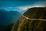 World's Most Dangerous Road or The Road of Death, is a 43 mile down hill mountain road leading from La Paz to Coroico in the Yungas region of Bolivia.  The road know for its extreme dropoffs, narrow width and turns, has been responsible for many accidents.  It is now a popular tourist destination for mountain bikers.