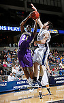24 MAR 2012:  Rory Blanche (21) of Western Washington University attempts to block the shot of DeMarcus Catchings (21) of the University of Montevallo during the Division II Men's Basketball Championship held at the Bank of Kentucky Center in Highland Heights, KY. Western Washington won the national title 72-65.  Joe Robbins/NCAA Photos