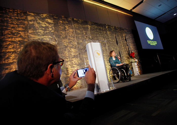 Ottawa, ON – Nov 27 2015 – Scott Russell takes a photo of Marni Abbott-Peter as she speaks at the Canadian Paralympic Hall of Fame in Ottawa, Ontario Nov 27, 2015. Photo Andre Forget / Canadian Paralympic Committee