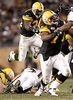 PITTSBURGH, PA - NOVEMBER 06:  Rashard Mendenhall #34 of the Pittsburgh Steelers runs with the ball while hurdling over Baltimore Ravens defenders during the game on November 6, 2011 at Heinz Field in Pittsburgh, Pennsylvania.  (Photo by Jared Wickerham/Getty Images)