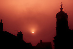 Eye is a small town in Suffolk England. Silhouette of town buildings