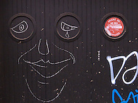 France. Paris. No parking sign on a garage door. Graffitti. 19.11.10  &copy; 2010 Didier Ruef