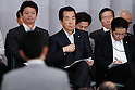 June 28th, 2011, Tokyo, Japan - Beleaguered Japanese Prime Minister Naoto Kan, left, attends a party caucus as the ruling Democratic Party of Japan calls on a general assembly of its members at the Diet in Tokyo on Tuesday, June 28, 2011. Defining for the first time conditions for fulfilling his June 2 pledge to resign, Kan said on Monday he would resign after the passage of three key bills - the second reconstruction budget, the renewable energy bill and the bond-issuance bill. Kan has been under pressure from both the opposition and his own Democratic Party of Japan to step down over his poor handling of the March 11 earthquake and tsunami that caused the biggest nuclear catastrophe in 25 years. (Photo by AFLO) [3609] -mis-...